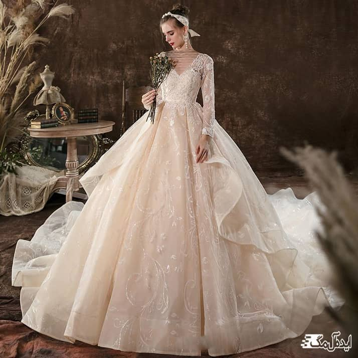 مدل لباس عروس آستین دار با دامن پفی